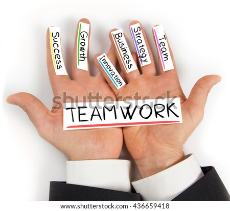 Photo of hands holding paper cards with TEAMWORK concept words - stock photo