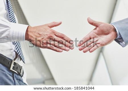 Photo of hands of business partners before handshake - stock photo