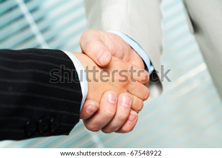 Photo of handshake of business partners after making agreement - stock photo