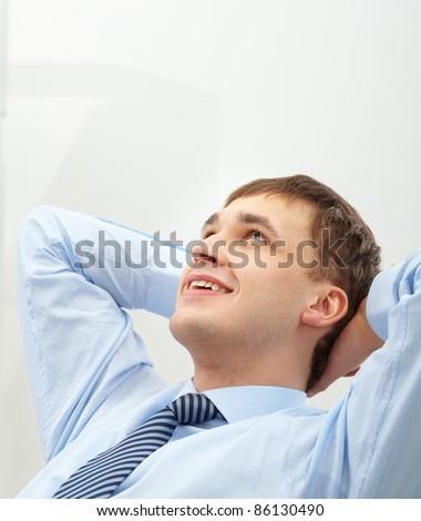 Photo of handsome businessman having short break - stock photo
