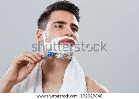 Photo of handsome man shaving chest,Man shaving his chest