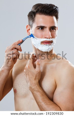 Photo of handsome man shaving his beard,Shaving the beard