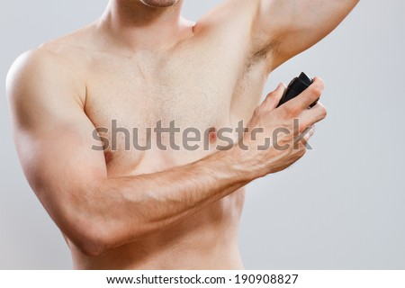 Photo of handsome man using deodorant,Man using  deodorant