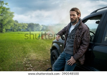 Photo of  handsome model near the car