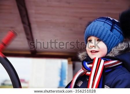 photo of happy child on autumn day - stock photo