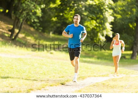 Photo of happy couple running in the morning outdoors - stock photo
