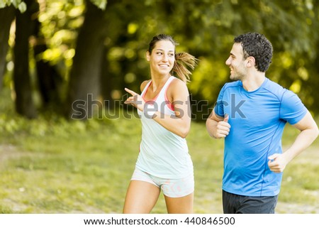 Photo of happy couple running in the morning outdoors