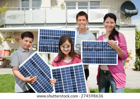 Photo Of Happy Family Carrying Solar Panels