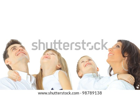 Photo of happy family looking upwards on white background - stock photo