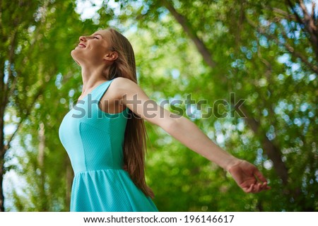 Photo of happy girl taking pleasure in summer day outside