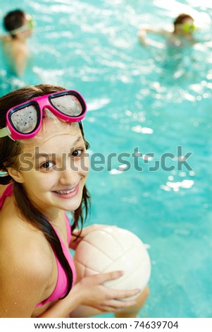 Photo of happy girl with ball smiling at camera - stock photo