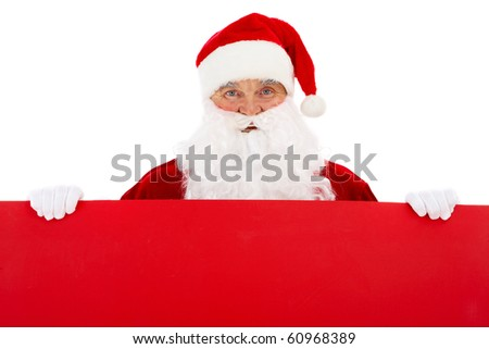 Photo of happy Santa Claus with red billboard - stock photo
