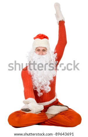 Photo of happy Santa Claus with the opened mitten
