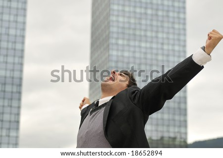 Photo of happy winner businessman  screaming from joy - stock photo