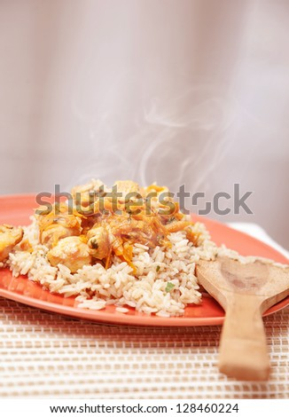 Photo of hot chicken meal with rice, traditional Chinese cereal with tasty prepared fish, healthy nutrition, organic food, dinner in restaurant, plate with spicy dish on the kitchen at home - stock photo