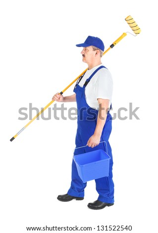 Photo of house painter on the way to work - stock photo