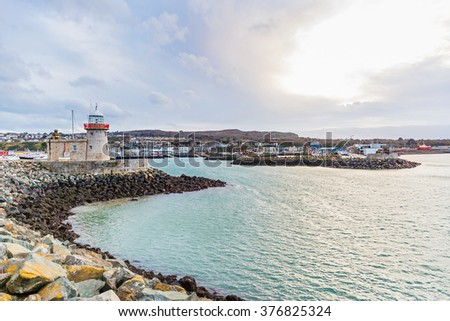 Photo of Howth lighthouse in Dublins harbour - stock photo