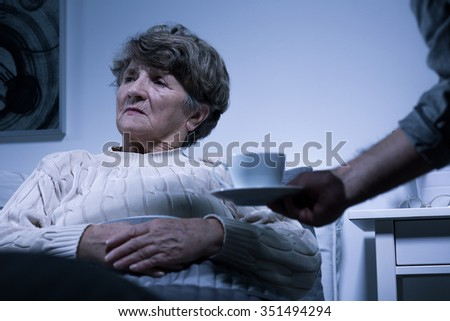 Photo of ill elderly woman with negative attitude - stock photo