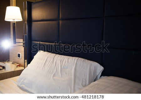 photo of Image of comfortable pillows and bed