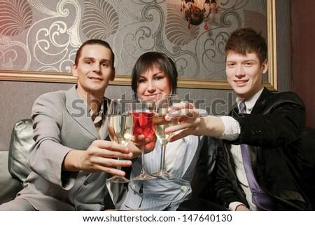 Photo of joyful friends in the bar - stock photo