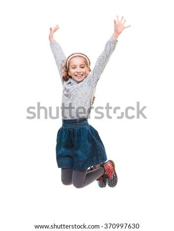 photo of joyful little girl jumping isolated on white background - stock photo