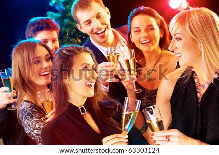 Photo of joyful people relaxing together at party