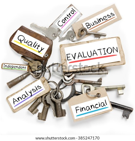 Photo of key bunch and paper tags with EVALUATION conceptual words - stock photo