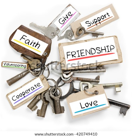 Photo of key bunch and paper tags with FRIENDSHIP conceptual words - stock photo