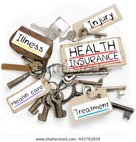 Photo of key bunch and paper tags with HEALTH INSURANCE conceptual words - stock photo