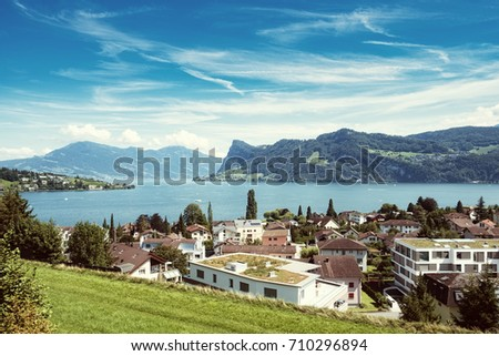 Photo of Lake Lucerne with the town Hergiswil, taken from above.