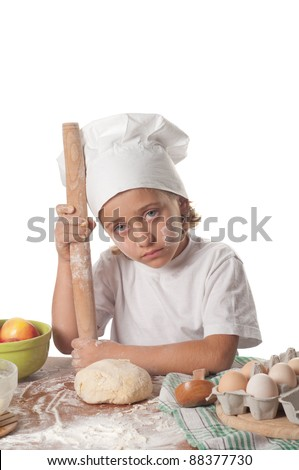 photo of little baker adorable, pretty little caucasian girl in chef hat. Cooking concept.