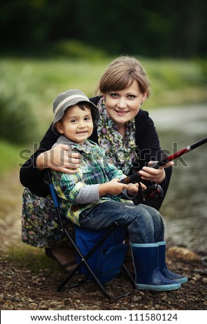 photo of little boy and mother fishing - stock photo
