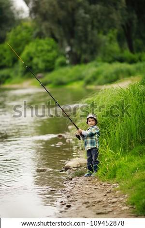 photo of little boy fishing - stock photo