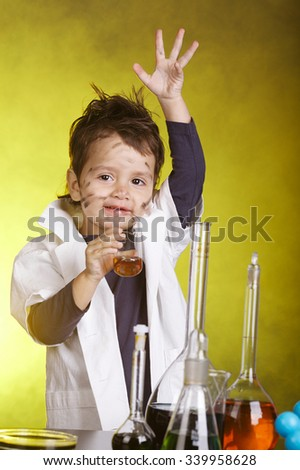 photo of little funny chemist at work - stock photo