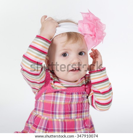 photo of little funny confused girl on white