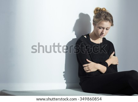 Photo of lonely depressed female with anorexia nervosa - stock photo