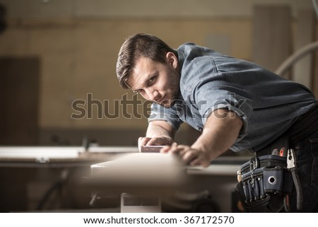 Photo of male wood expert checking quality of board - stock photo
