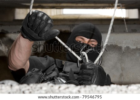 Photo of man in combat uniform playing terrorist or special forces team member - stock photo