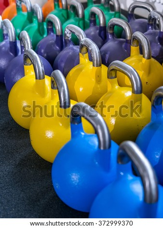 Photo of many kettlebells at a gym.   - stock photo
