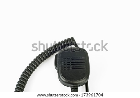 Photo of microphone on white background.