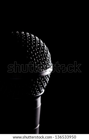 Photo Of Microphone's Head. Black Background. - stock photo