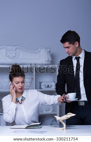 Photo of modern confident businesswoman and her male secretary - stock photo