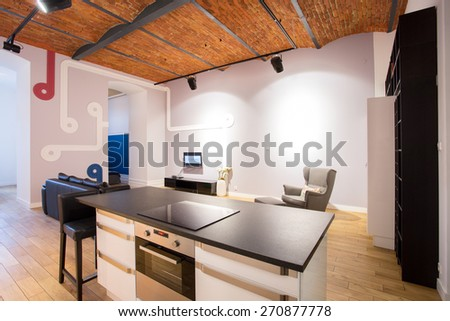 Photo of modern interior with brick ceiling