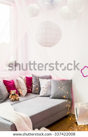 Photo of modern kid bedroom with comfortable bed - stock photo