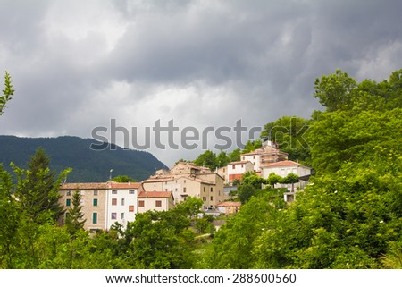 Photo of mountain village under the summer storm - stock photo