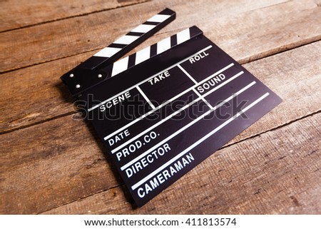 photo of movie clapper on wood - stock photo