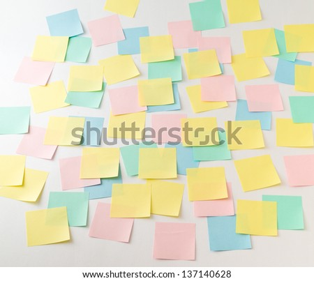 Photo of multicolored empty paper stickers on wall front view - stock photo