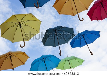 Photo of multicolors umbrellas. Photo for business concepts, financial concepts, security concepts and many other.
