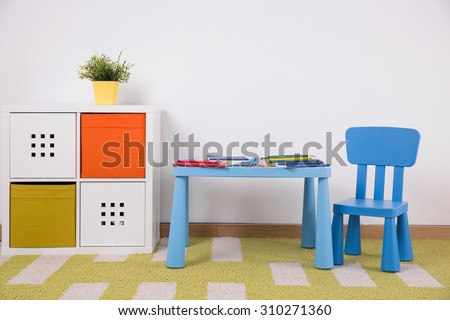 Photo of neat furnished space for creative child activity - stock photo