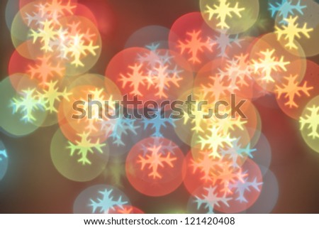Photo of New Year's garlands through a snowflake cliche - stock photo